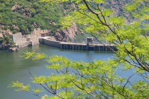 What are the major pros and cons of hydroelectric power?