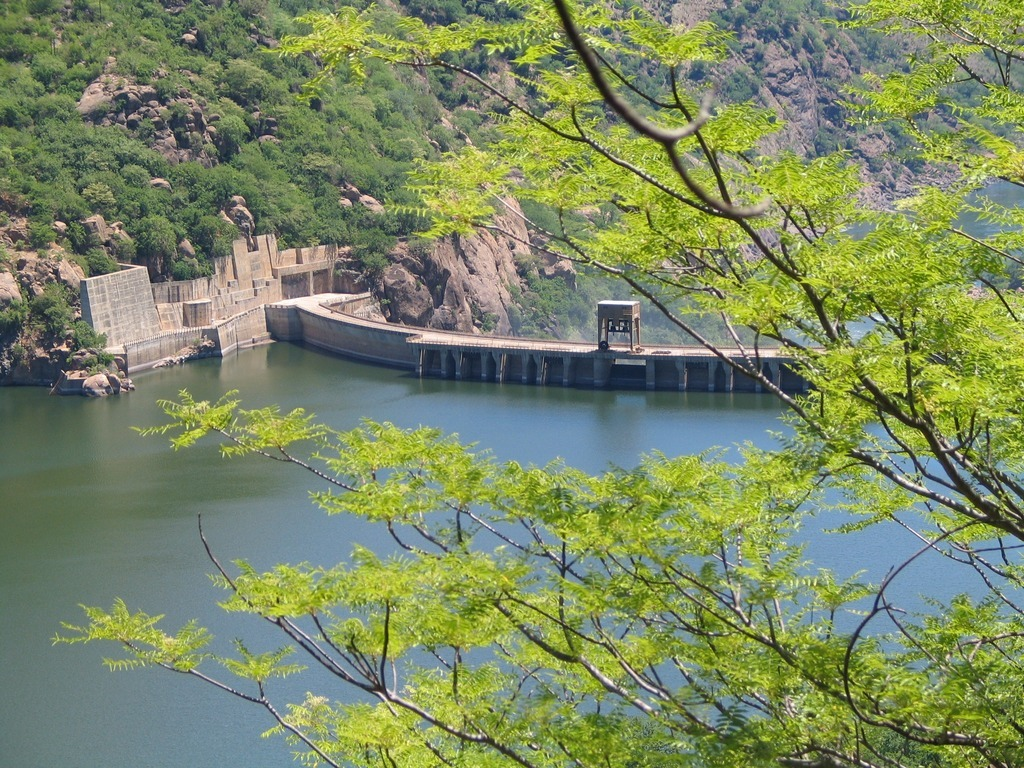 What are the pros and cons of hydroelectric power generation?