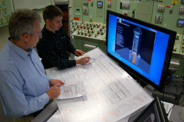 Simulator in use by Joe Yarbrough (right) and Mike Petersen (left)