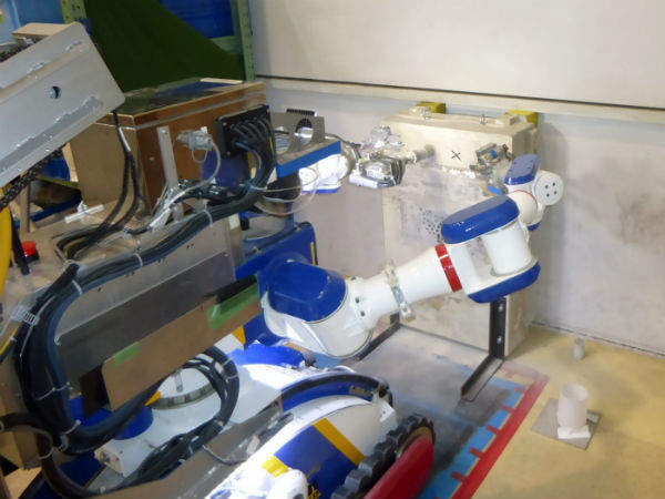 MEISTeR performing suction decontamination work inside the Unit 1 at Fukushima Daiichi Nuclear Power Station