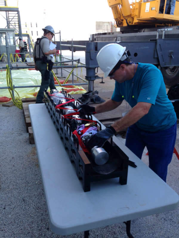 A GEH technician prepares the Surveyor ultrasonic inspection robot for deployment at South Texas Project