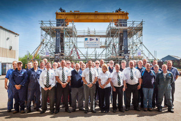 TM Engineers in front of submarine decom crane to be used at Devonport