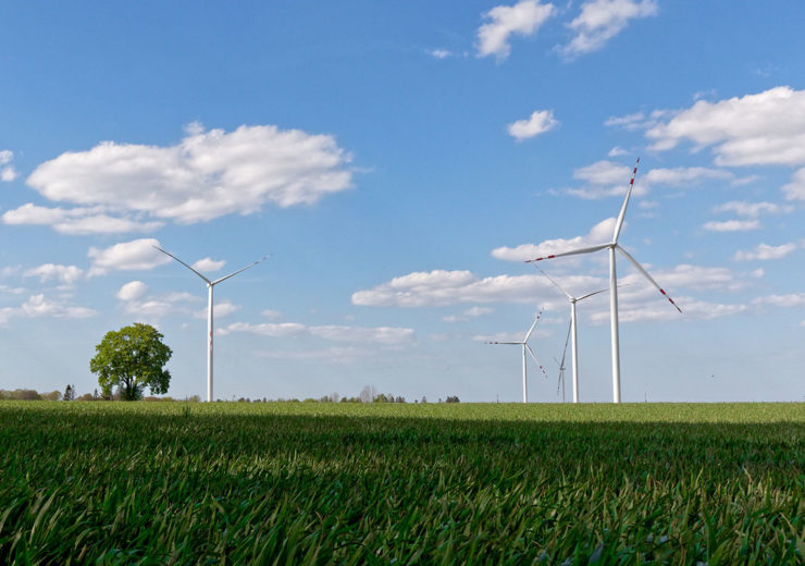 wind-turbines-green-field-poland-blue-sky-clouds-tree