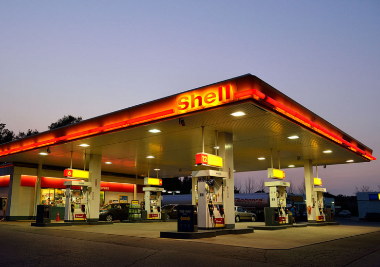Shell confirms dividend cut as first-quarter earnings almost halve