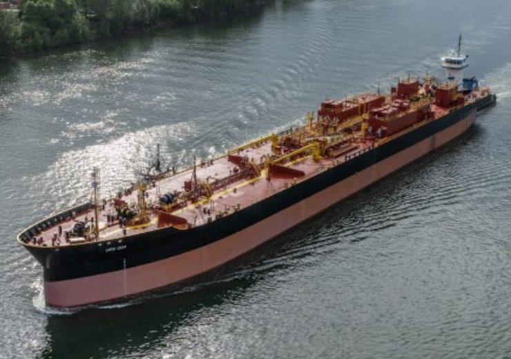 Departing barge OSG 204