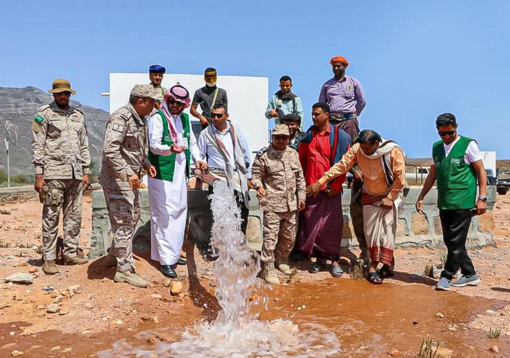 water flowing in desert with men