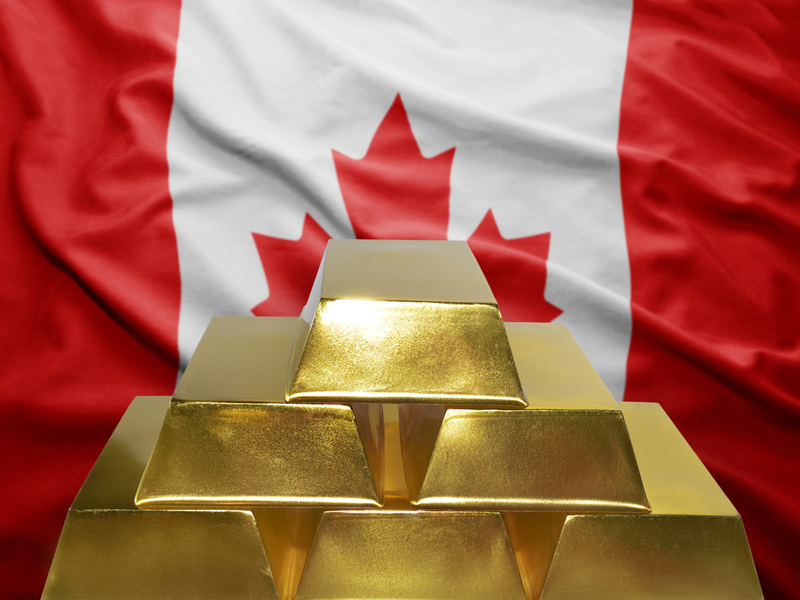 shining golden bullions on the canadian flag_shutterstock_368013134
