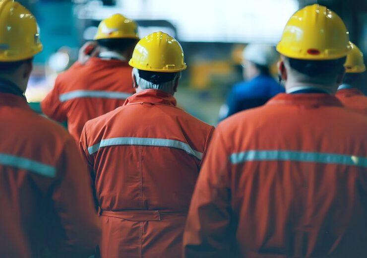 Workers - Kichigin - Shutterstock 1038834505
