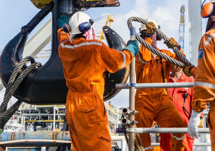 Offshore,Workers,Installing,Big,Sling,Onto,Crane,Block,In,Preparation