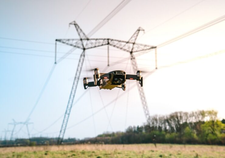 Drone,Flying,And,High,Voltage,Electricity,Pillars,On,The,Sunset